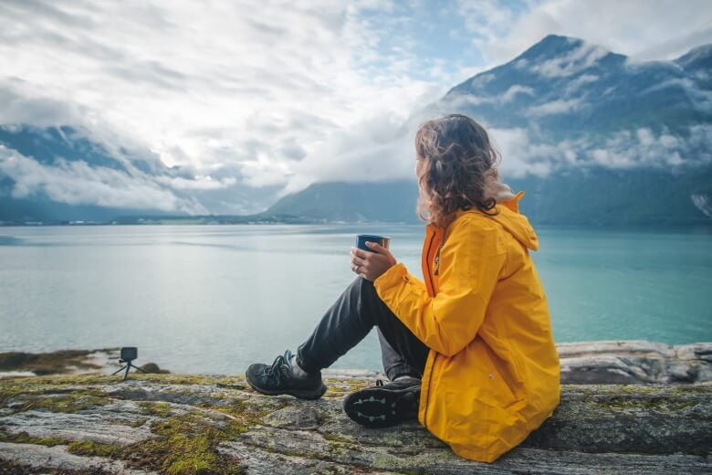 woman drinks coffee in norway