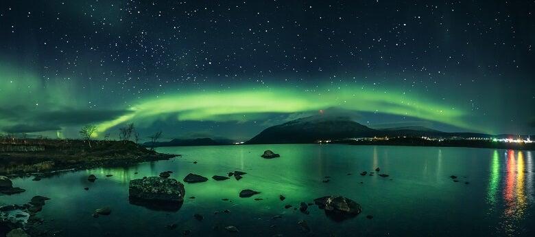 Northern lights near a lake