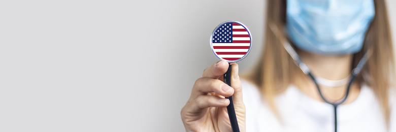 a doctor with a stethoscope featuring the US flag