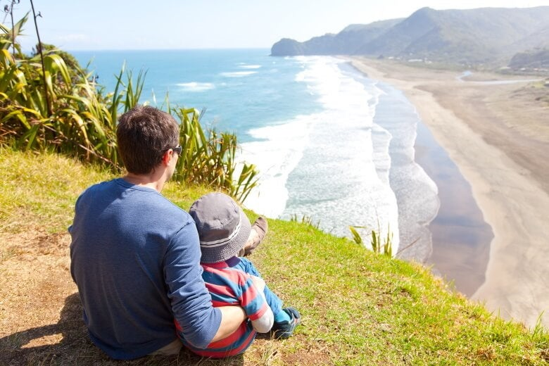a father and son on a new zealand beach