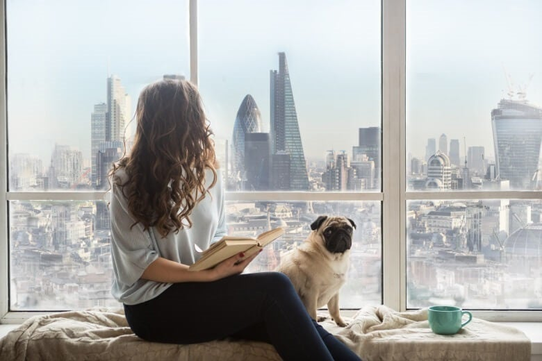 a woman looks out at london