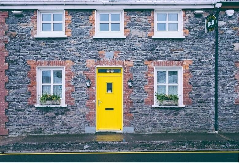 Yellow front door on English street