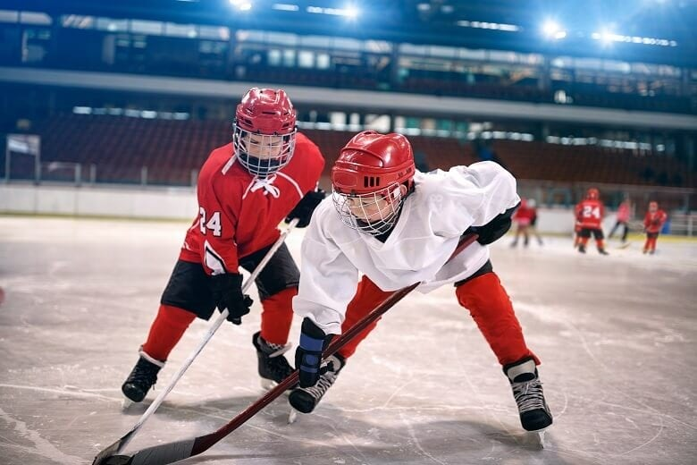 Kids playing ice hockey in Canada