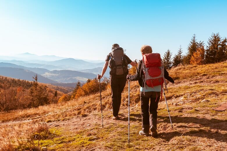 a couple hiking to stay healthy