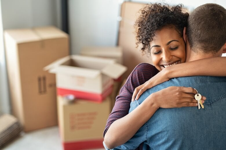 man and woman hugging while moving in