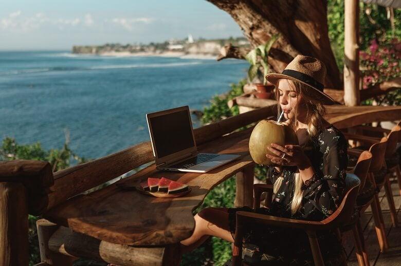 lady working remotely near beach
