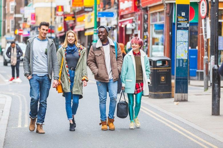 a group of friends walking down a London street