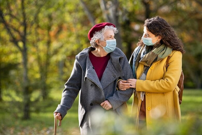 Two family members walking with facemasks on