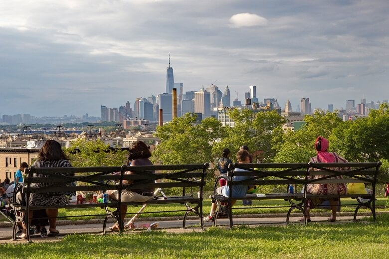 People in park looking at New York