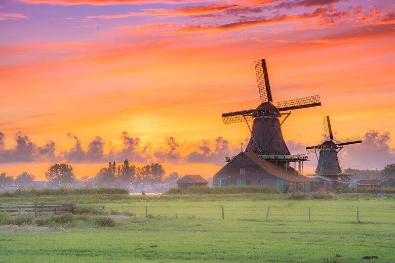 A sunset behind Dutch windmill